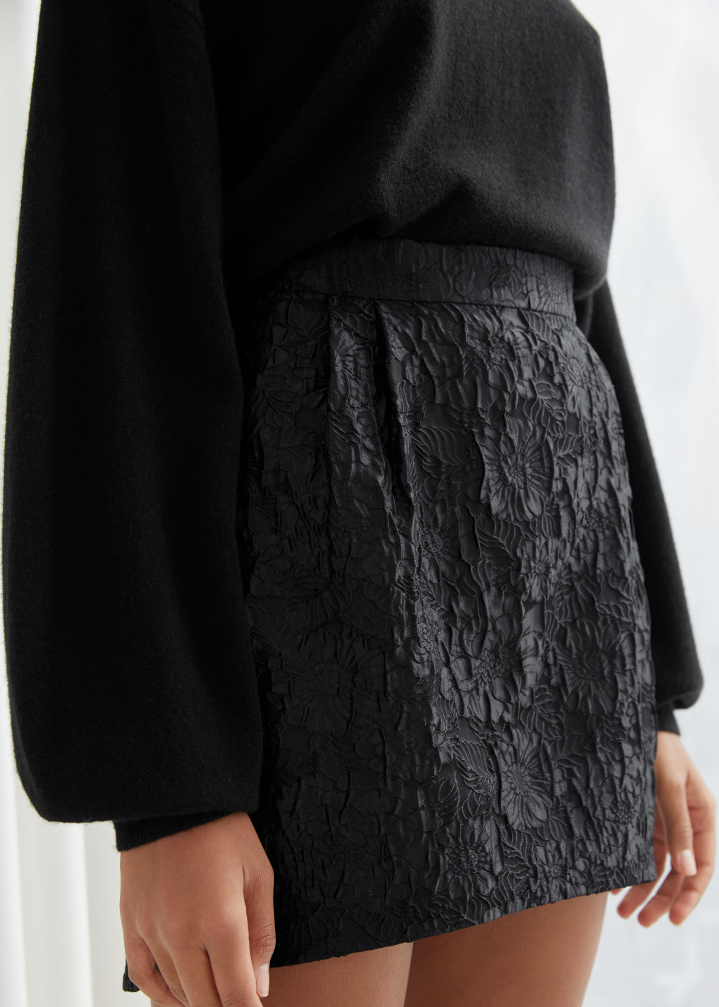 Model front image of Stories floral jacquard mini skirt in black