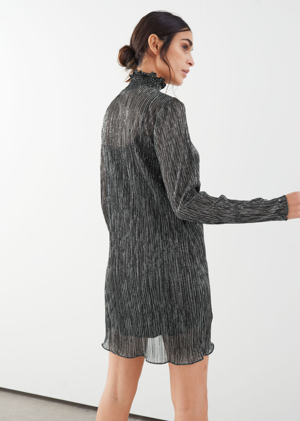 Model back image of Stories smocked turtleneck mini glitter dress in black