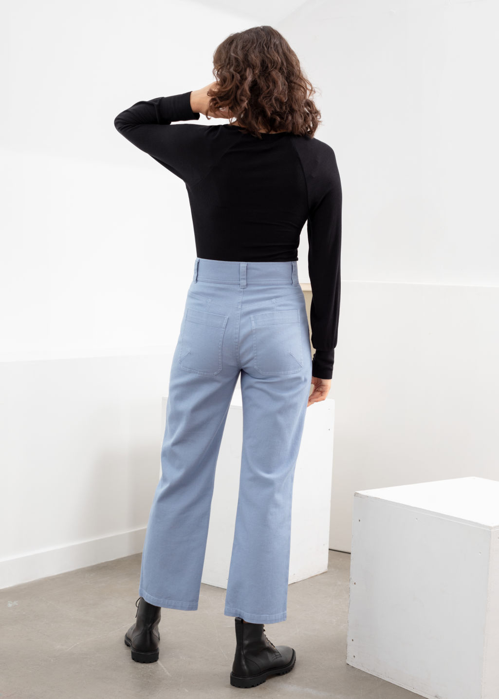 Model back image of Stories topstitch workwear trousers in blue