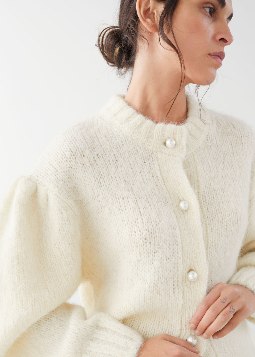 Model front image of Stories pearl button puff sleeve cardigan in white