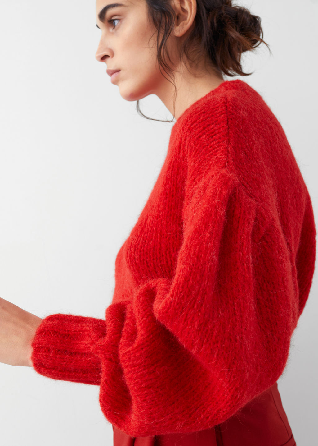 Model side image of Stories wool blend puff sleeve sweater in red