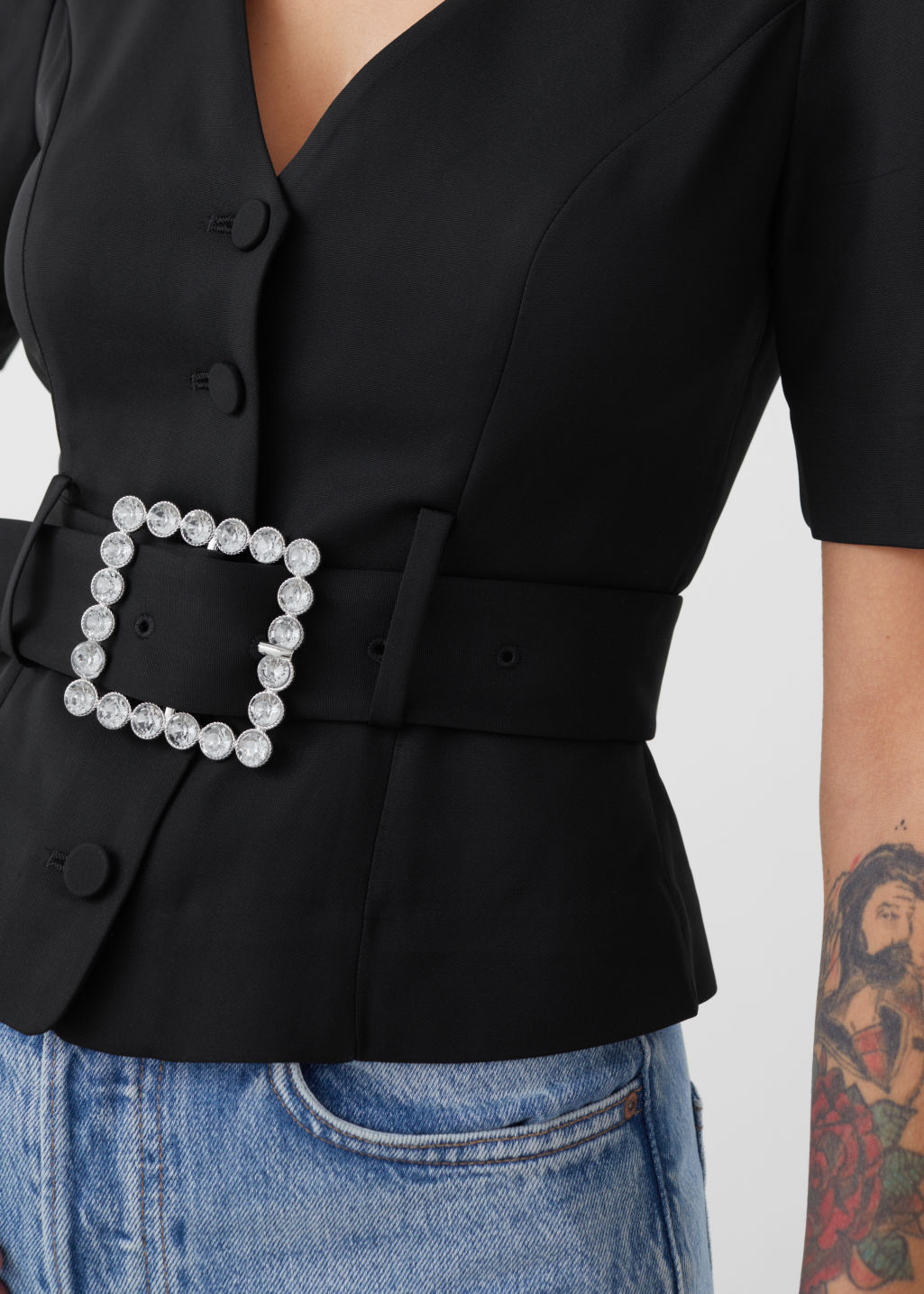 Model front image of Stories belted puff shoulder blouse in black