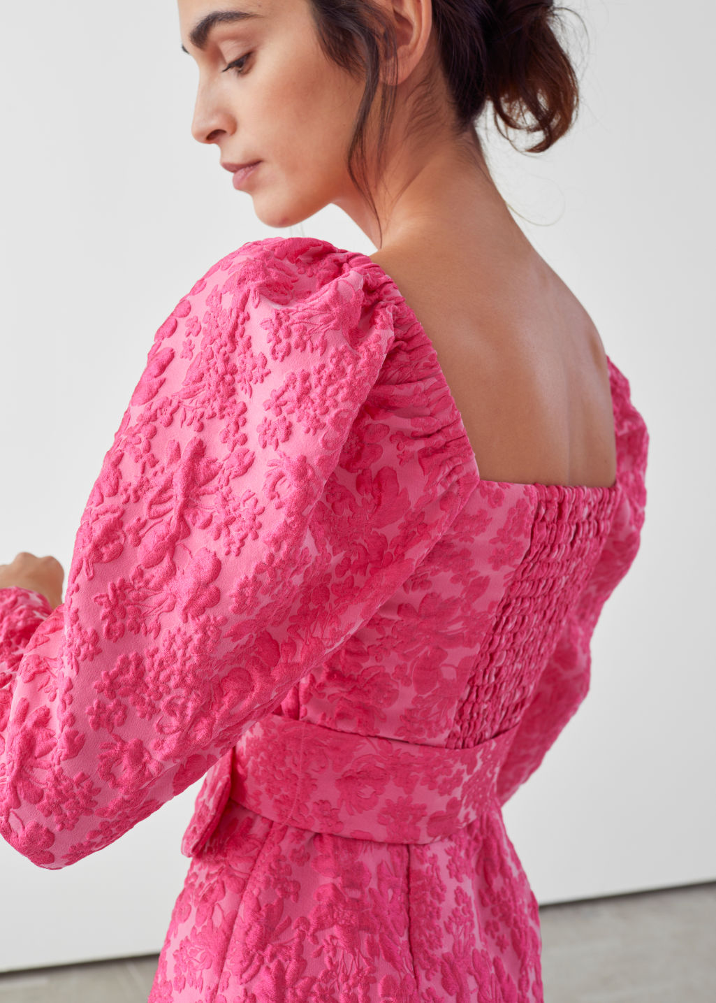 Model side image of Stories belted puff sleeve jacquard mini dress in pink