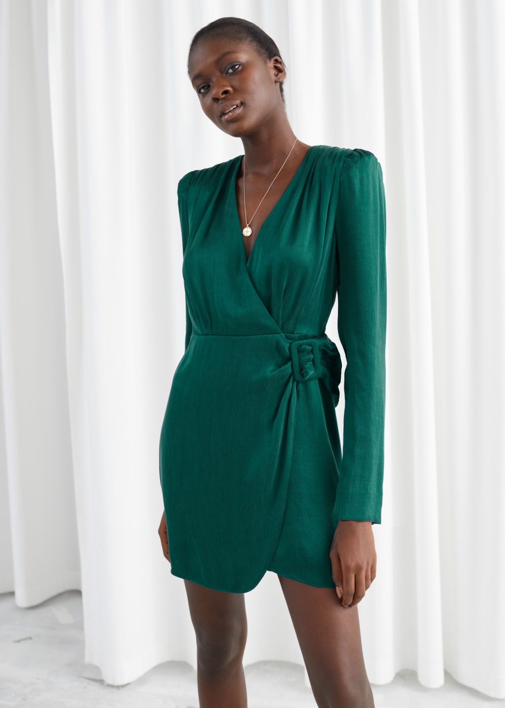 Model front image of Stories satin buckle tie mini wrap dress in green