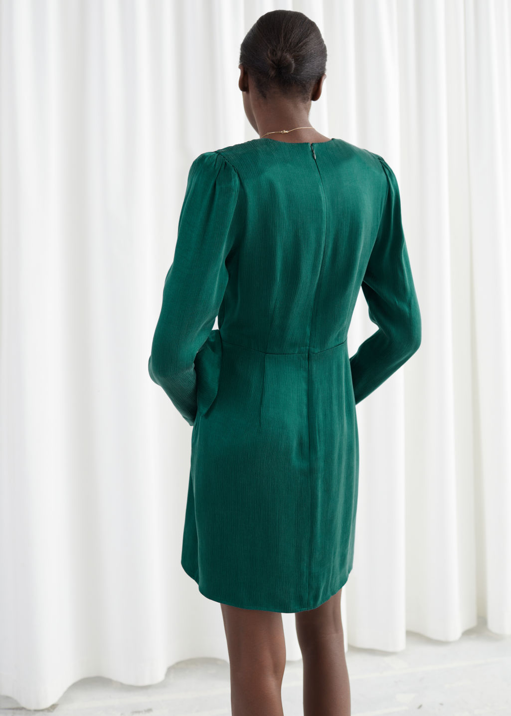 Model back image of Stories satin buckle tie mini wrap dress in green
