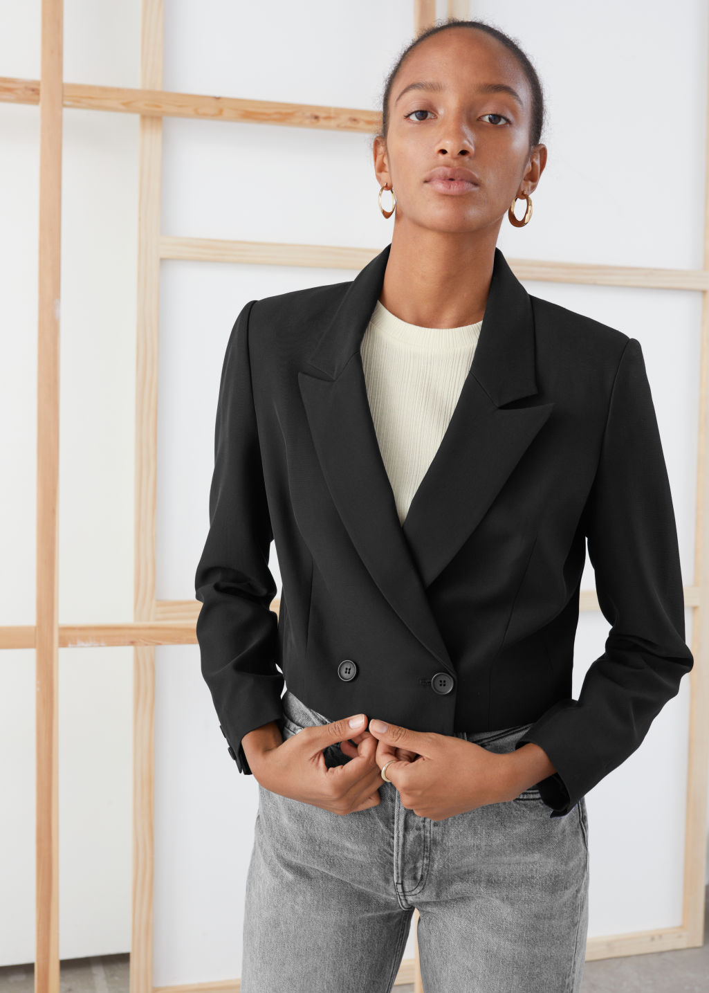 Model front image of Stories cropped tailored blazer in black