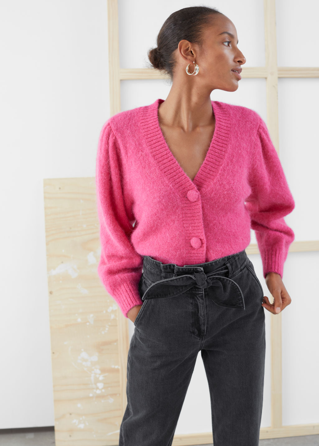Model front image of Stories puff sleeve cropped cardigan in pink
