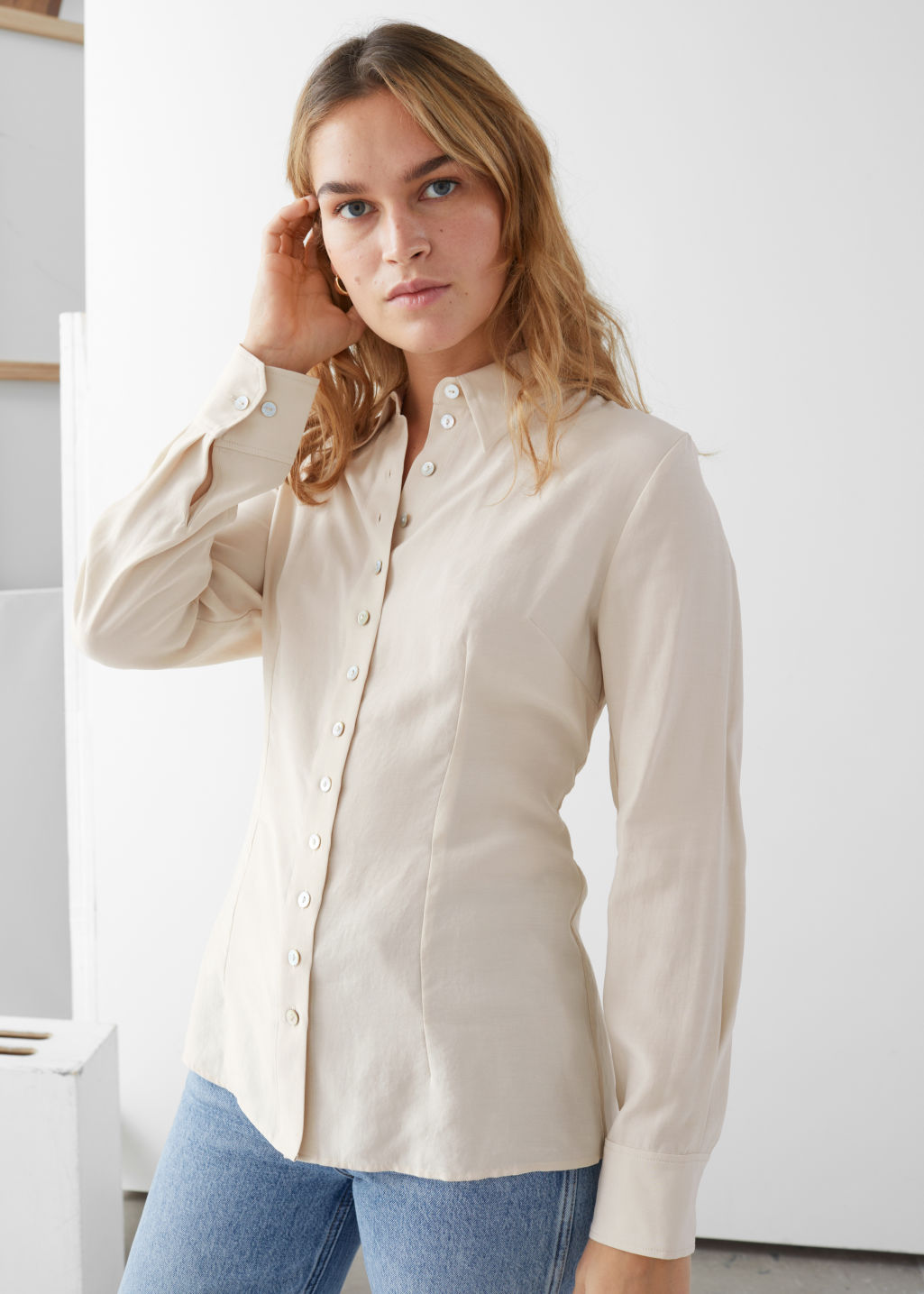 Model front image of Stories classic fit shell button shirt in beige