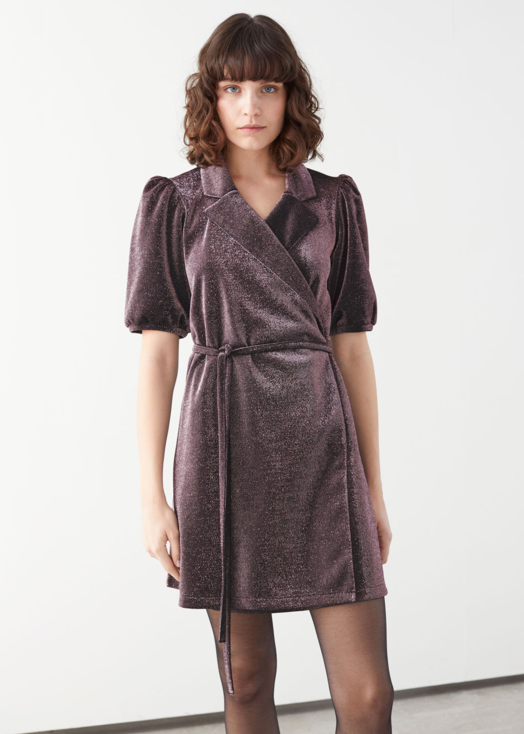 Model front image of Stories belted glitter mini wrap dress in purple