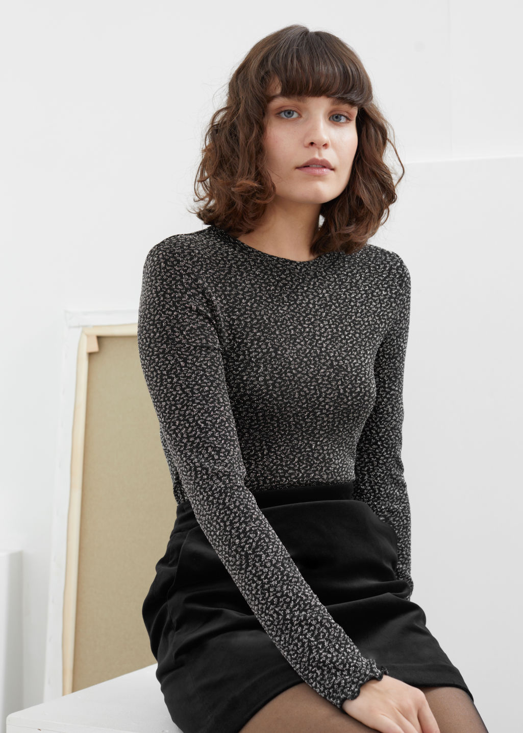 Model front image of Stories fitted metallic jacquard top in black