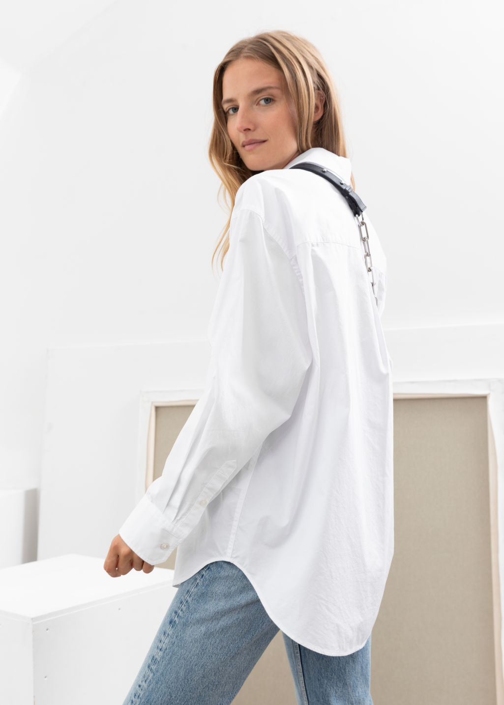 Model back image of Stories oversized organic cotton shirt in white