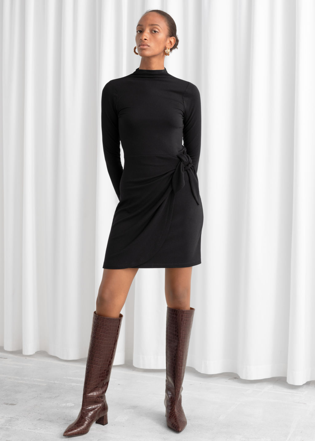 Model front image of Stories knot tie ribbed mini dress in black