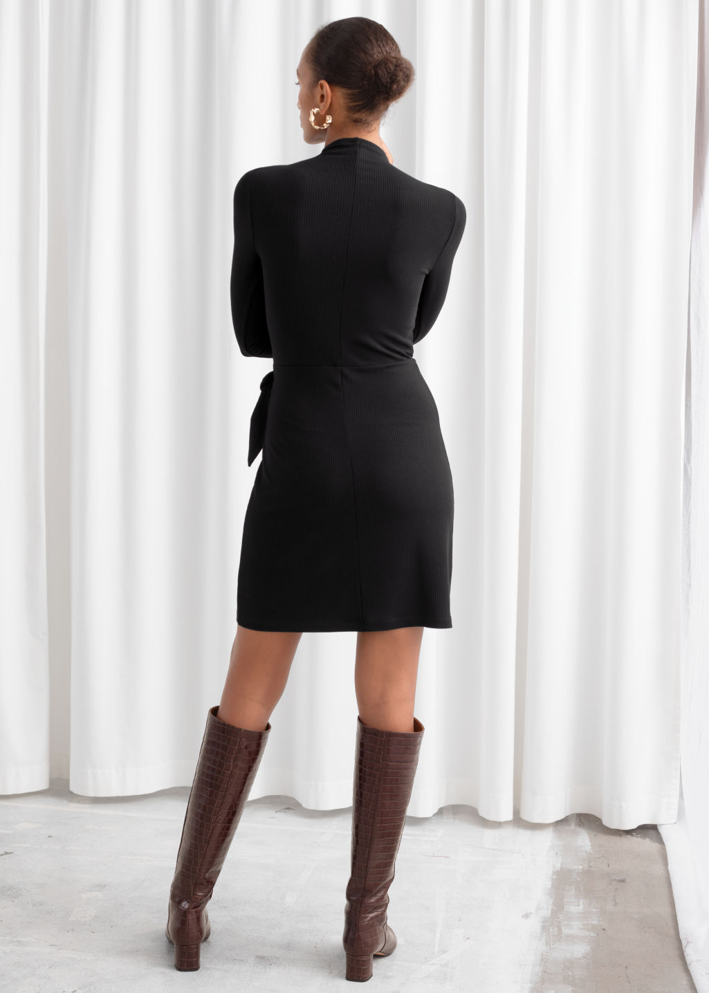 Model back image of Stories knot tie ribbed mini dress in black