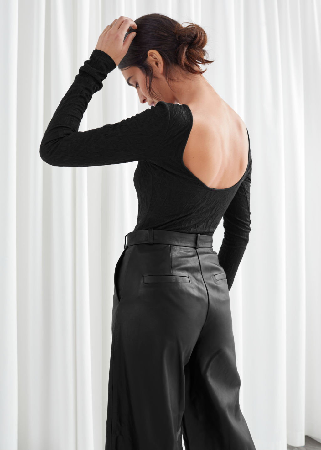 Model back image of Stories fitted scoop back jacquard top in black