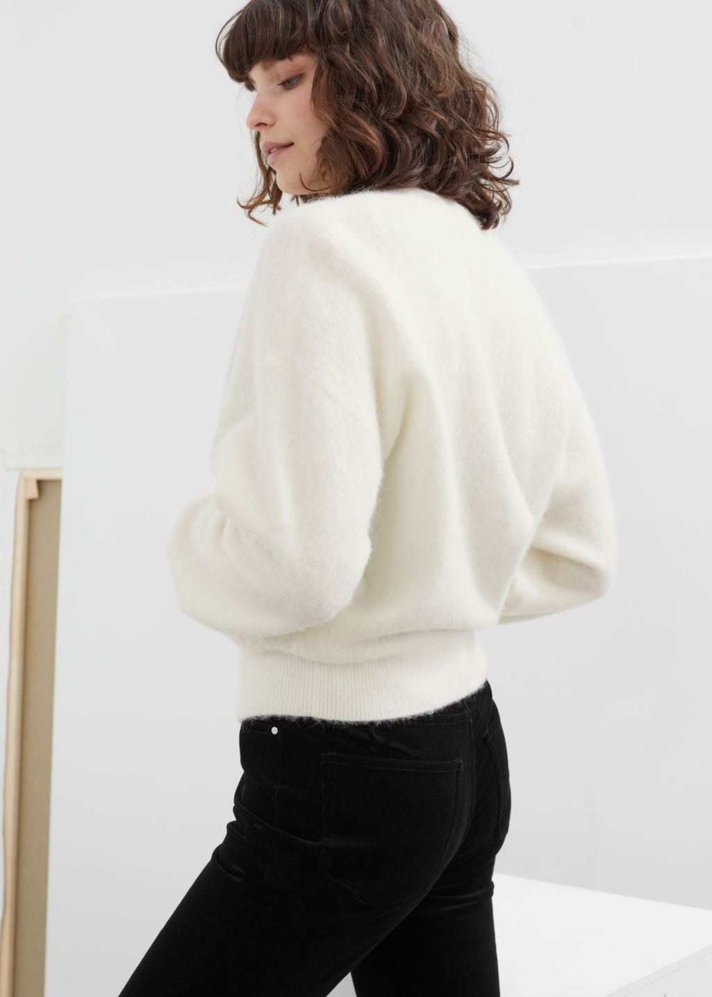 Model back image of Stories crystal flower button wool cardigan in white