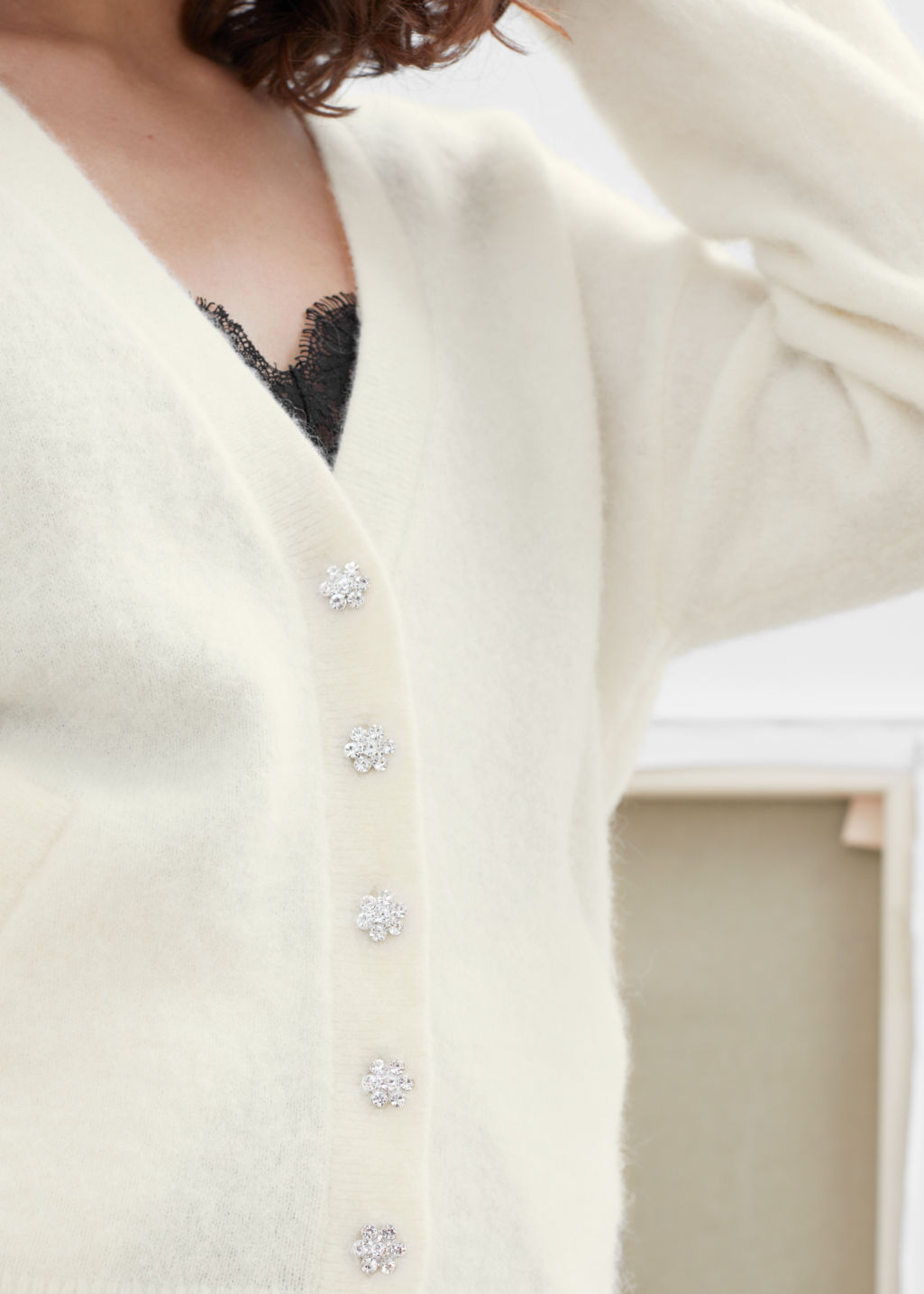 Model front image of Stories crystal flower button wool cardigan in white