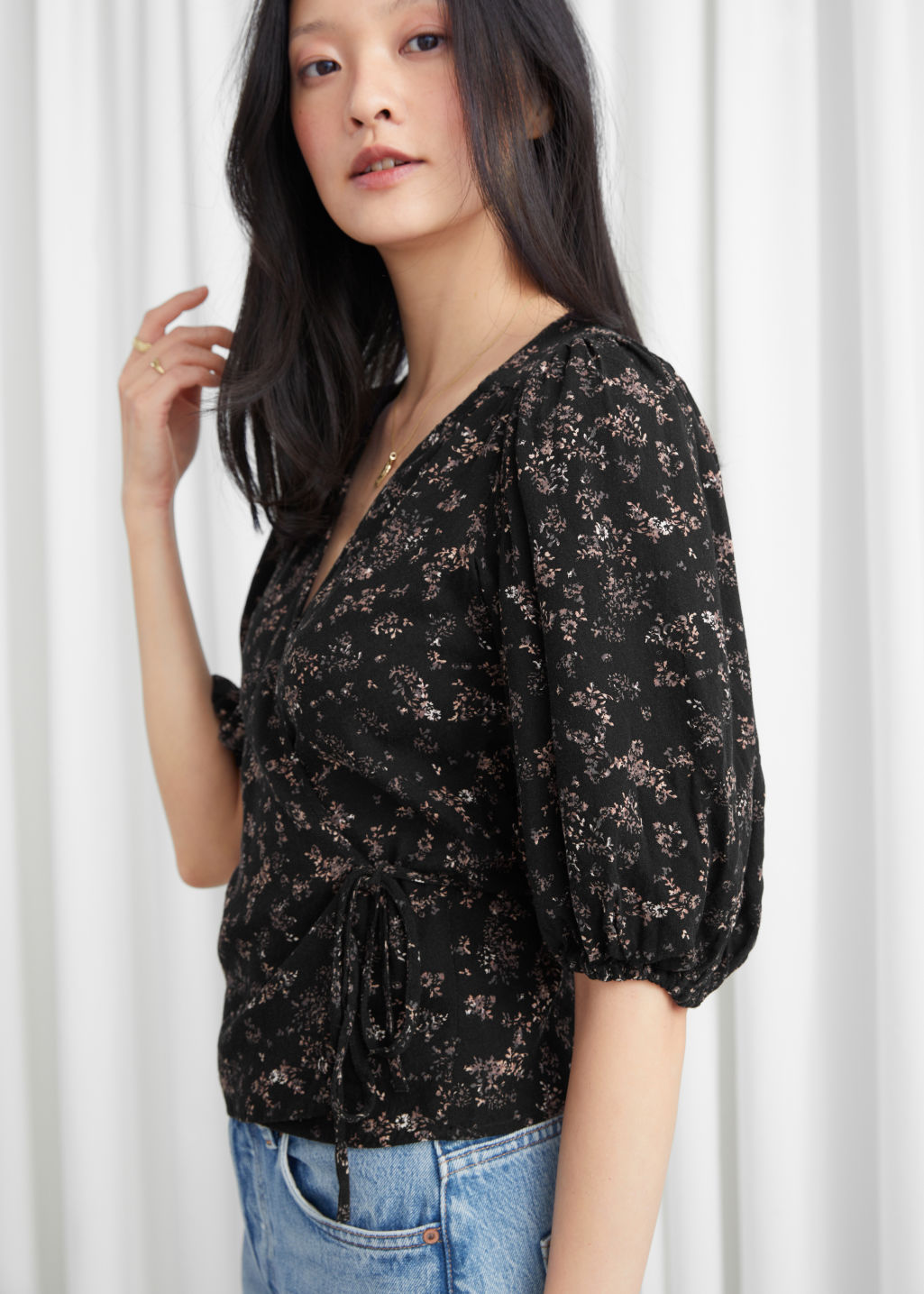 Model side image of Stories jacquard puff sleeve wrap blouse in black