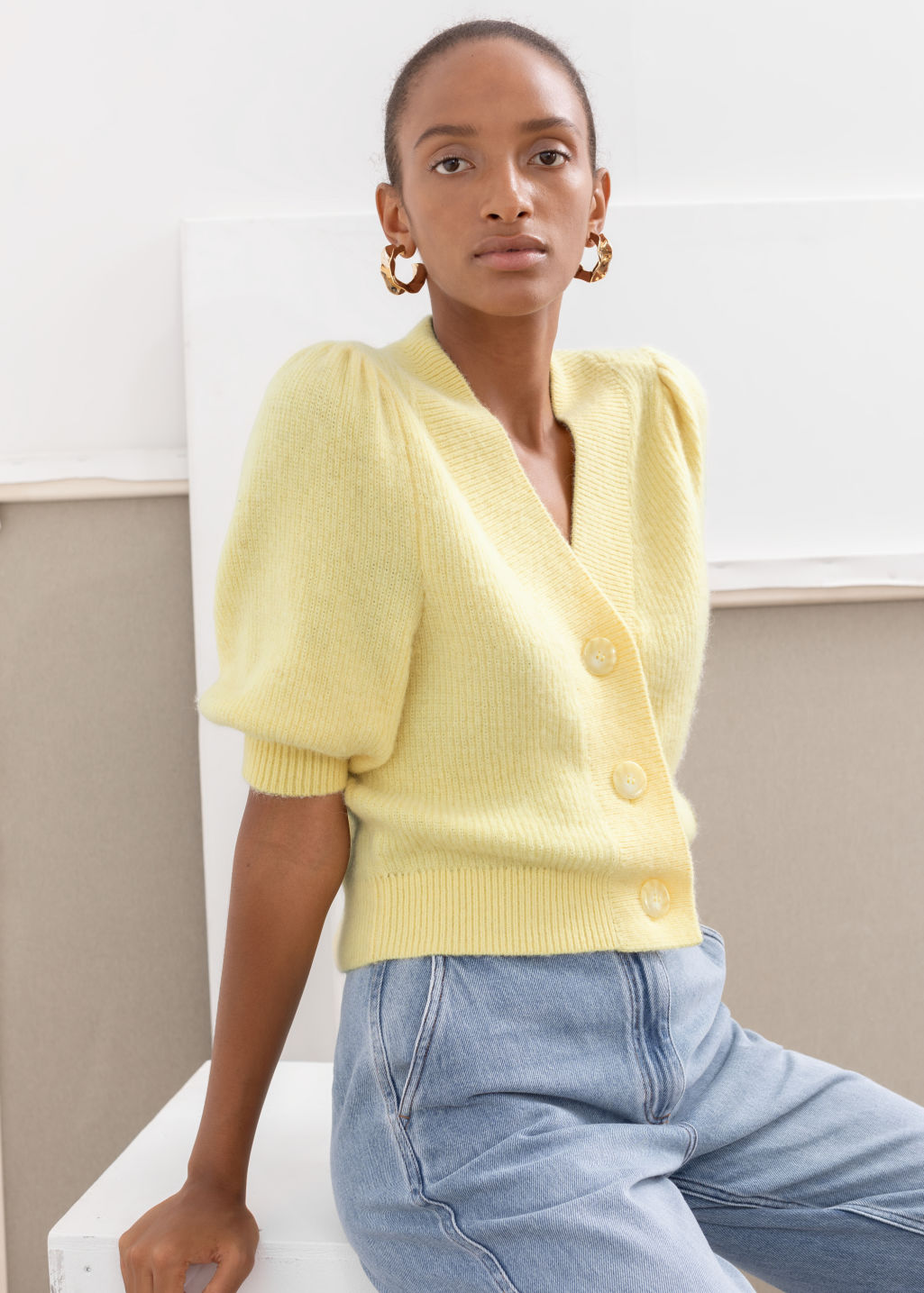 Model front image of Stories puff sleeve wool blend cardigan in yellow
