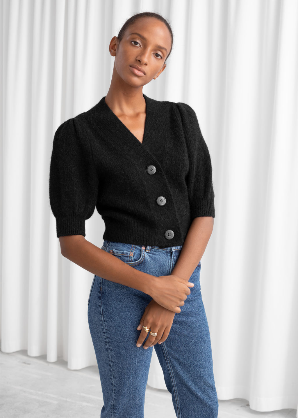 Model front image of Stories puff sleeve wool blend cardigan in black