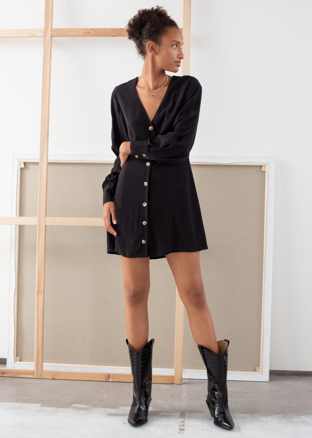 Model front image of Stories flowy button up mini dress in black