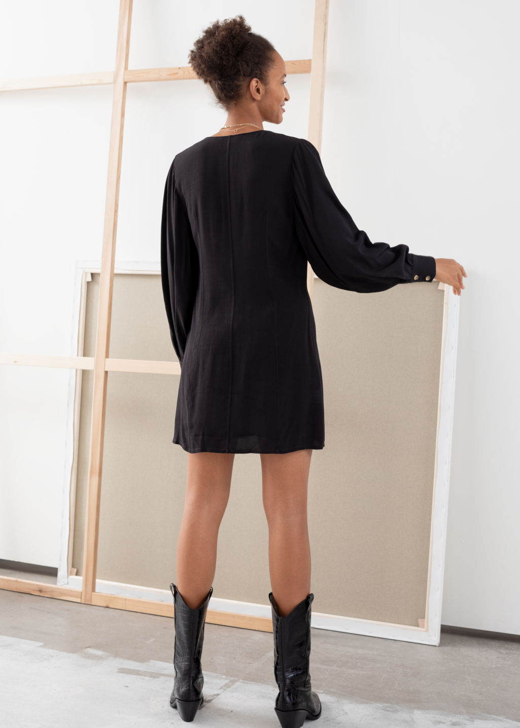 Model back image of Stories flowy button up mini dress in black