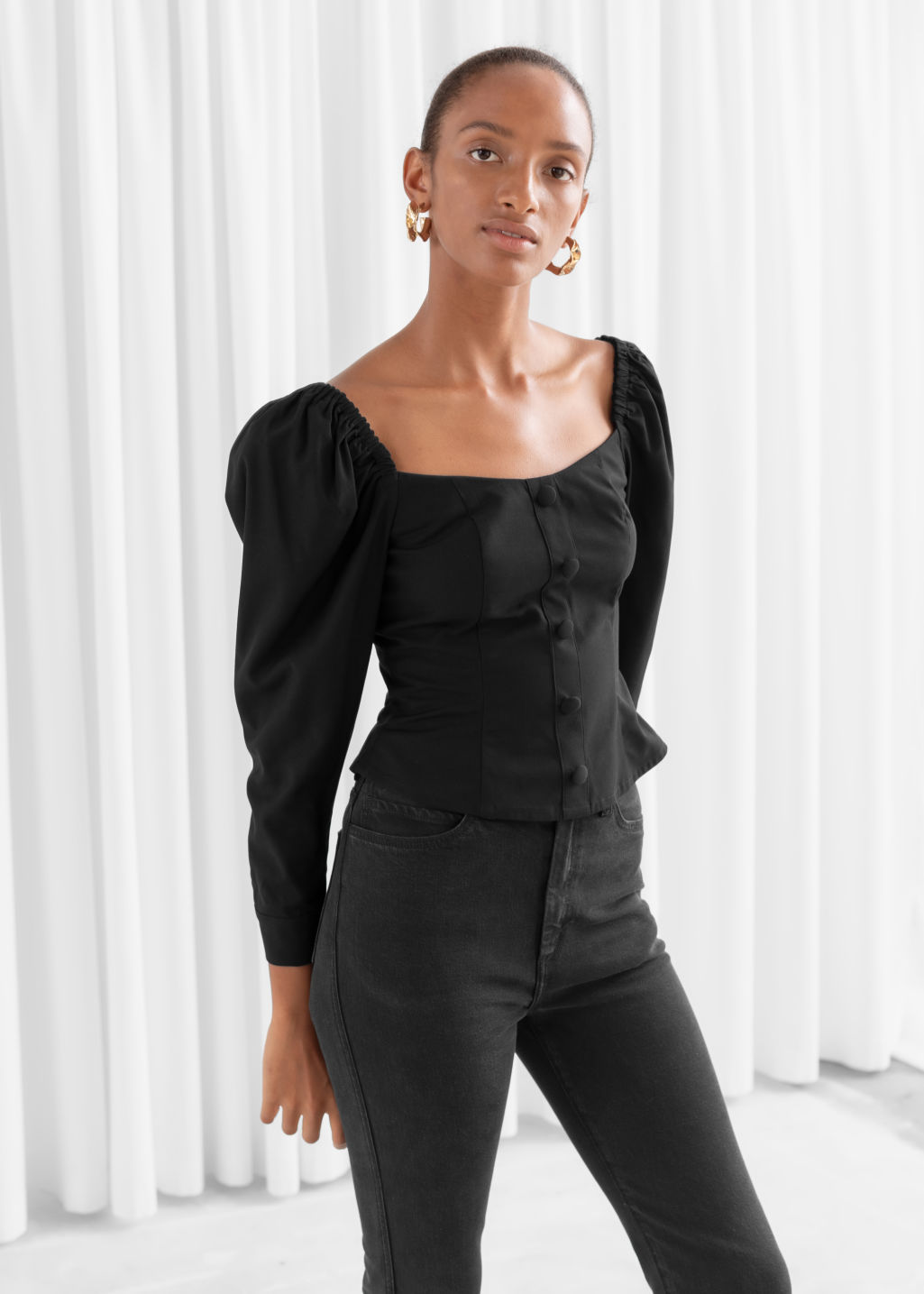 Model front image of Stories square neck smocked blouse in black