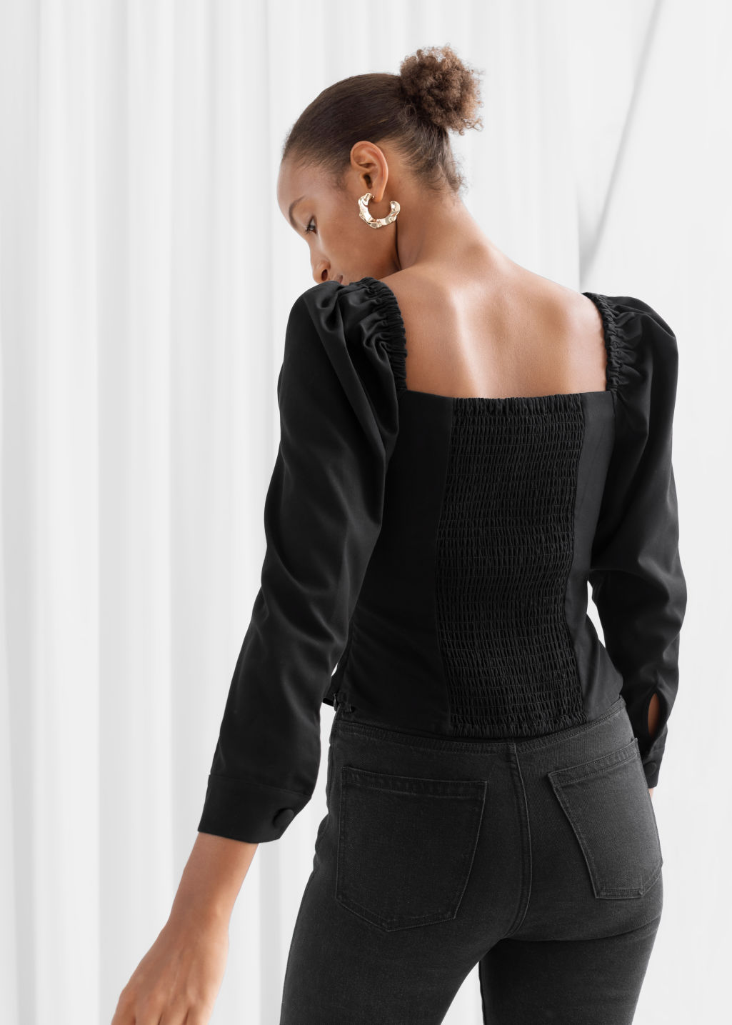 Model back image of Stories square neck smocked blouse in black