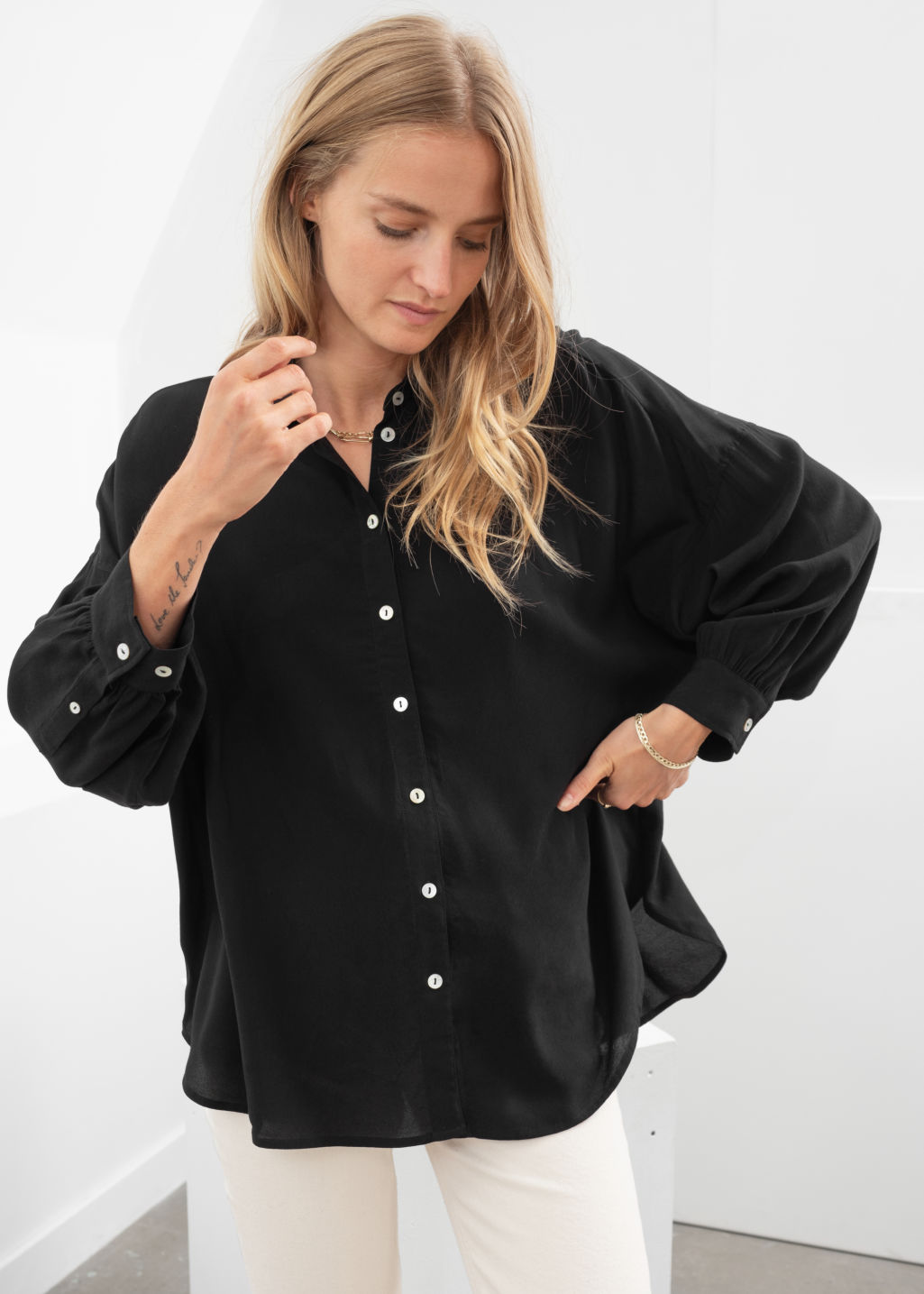 Model front image of Stories flowy button up shirt in black