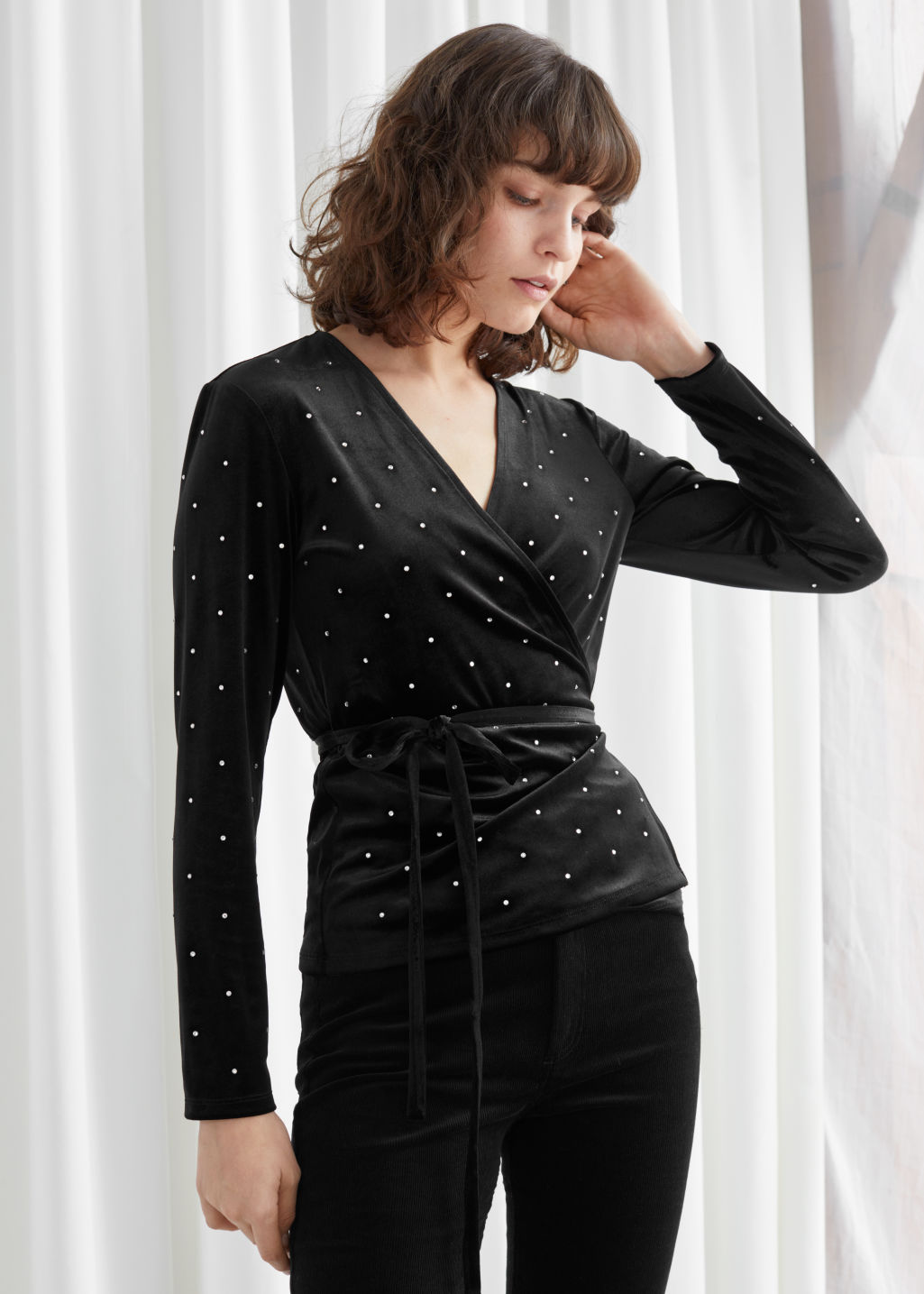 Model front image of Stories rhinestone velvet wrap blouse in black