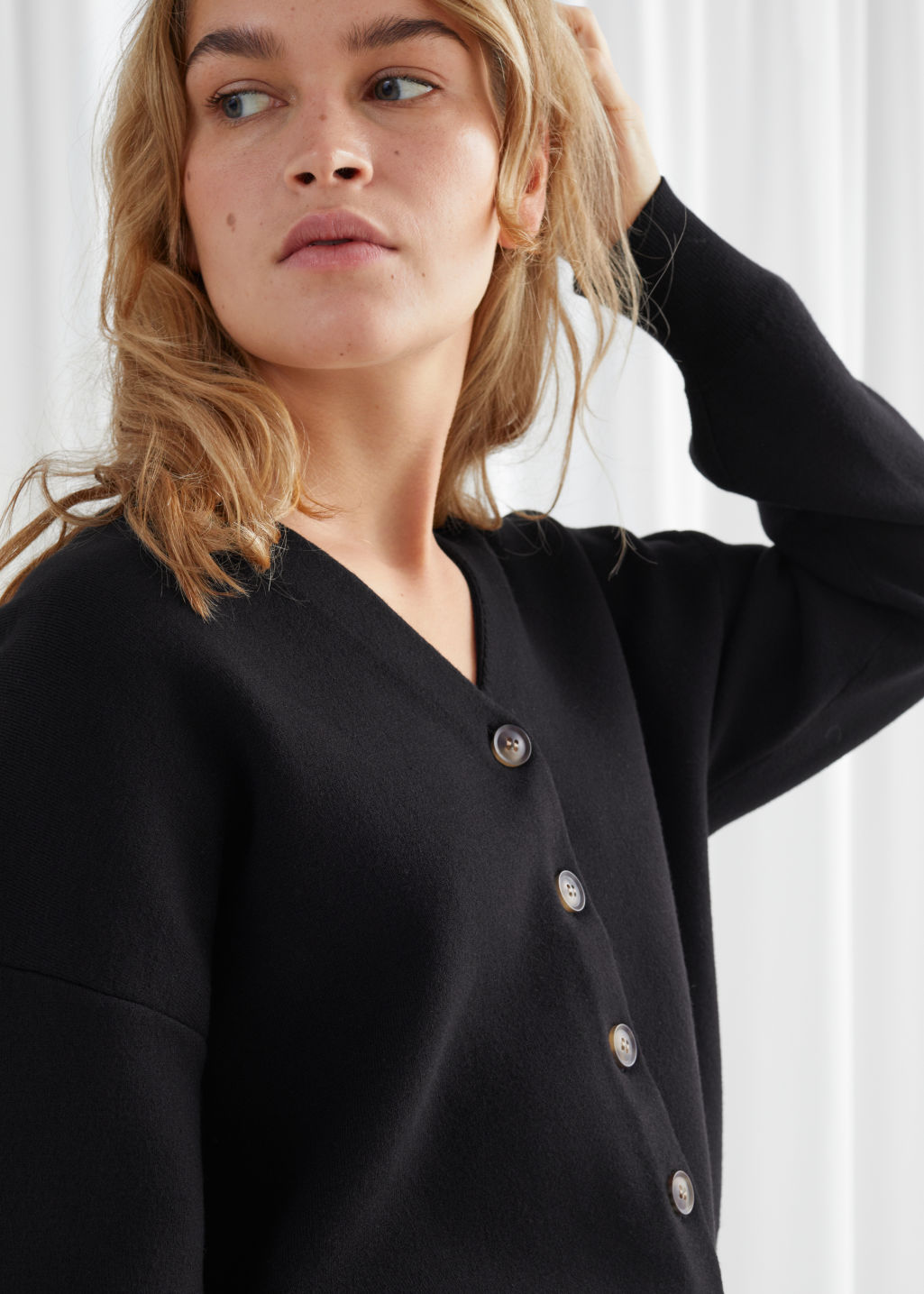 Model front image of Stories boxy plunging v-cut cardigan in black