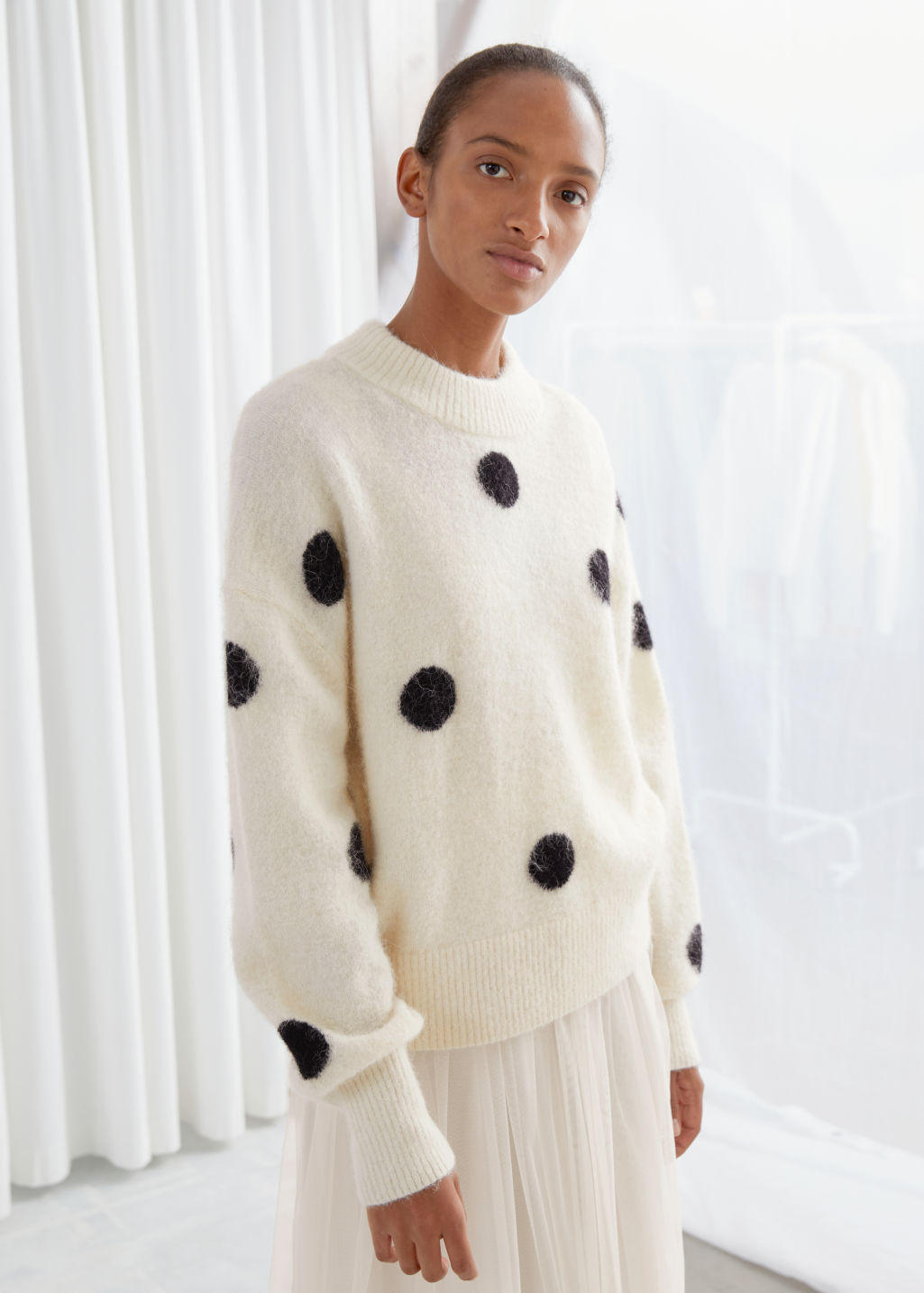 Model front image of Stories wool blend polka dot sweater in white