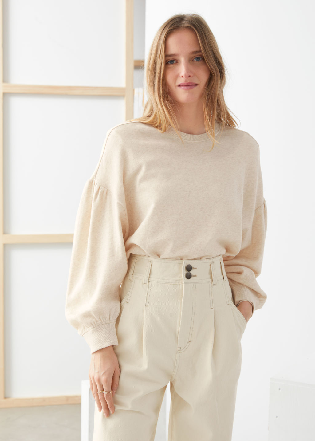 Model front image of Stories organic cotton puff sleeve sweater in beige
