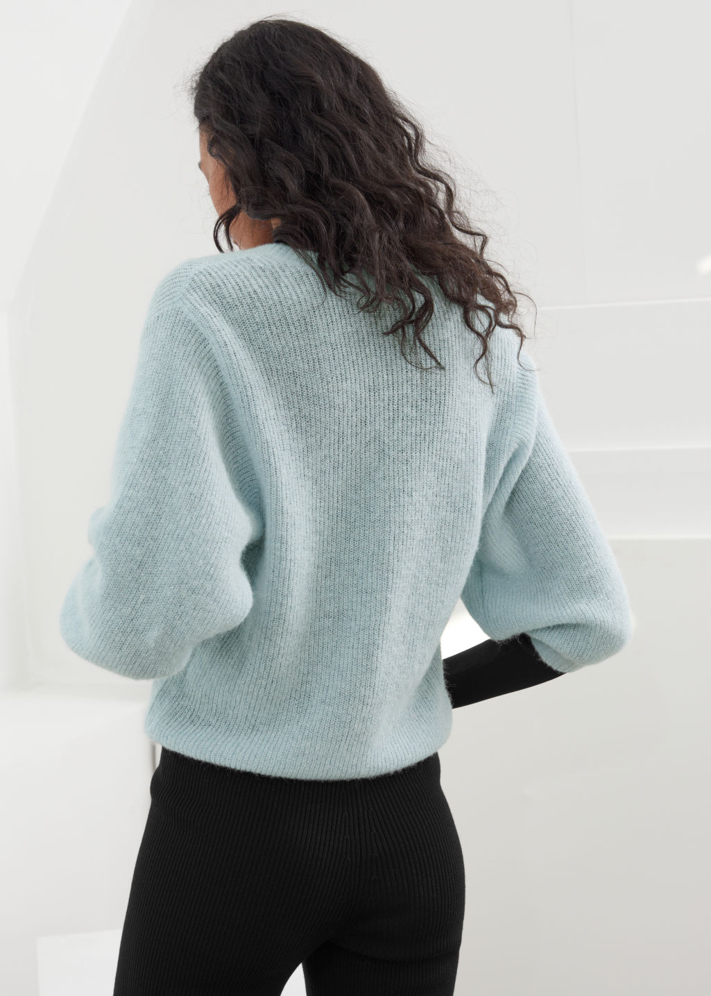 Model back image of Stories glitter wool blend puff sleeve cardigan in turquoise