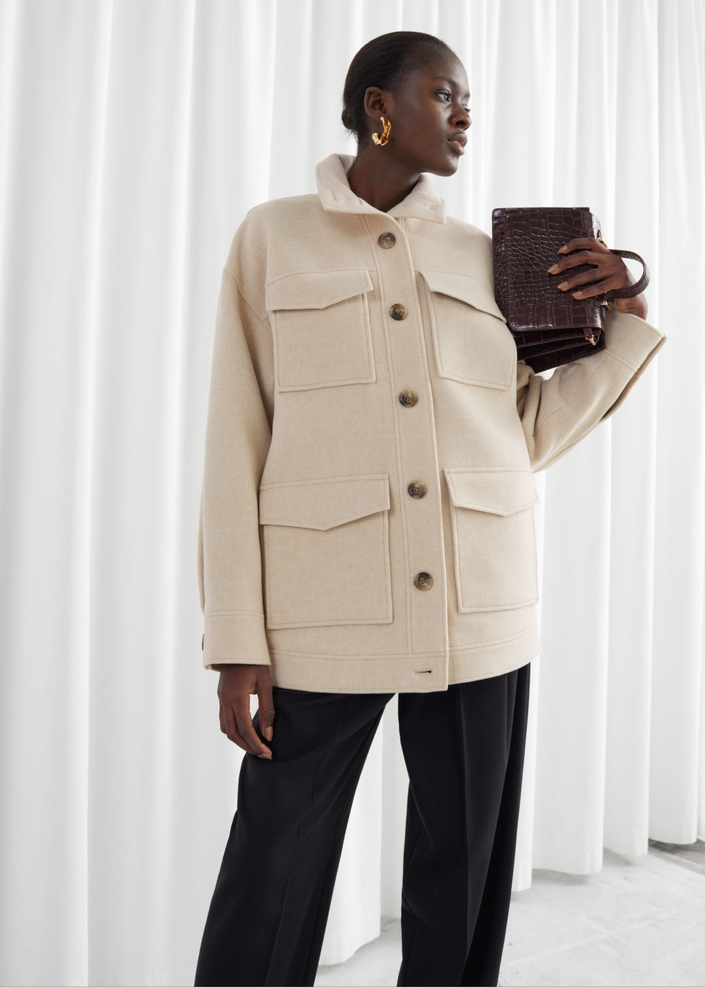 Model front image of Stories oversized wool blend utility jacket in beige