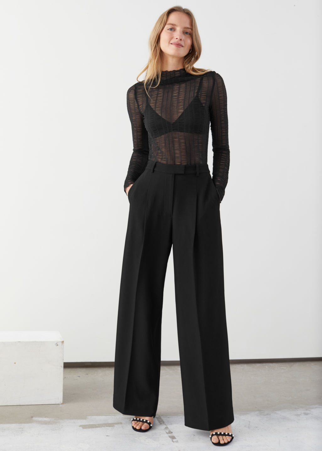 Model front image of Stories tailored relaxed trousers in black