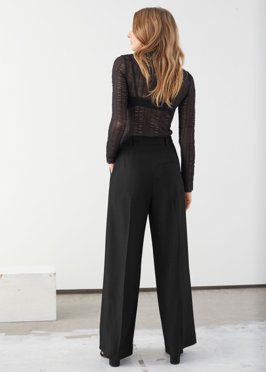 Model back image of Stories tailored relaxed trousers in black