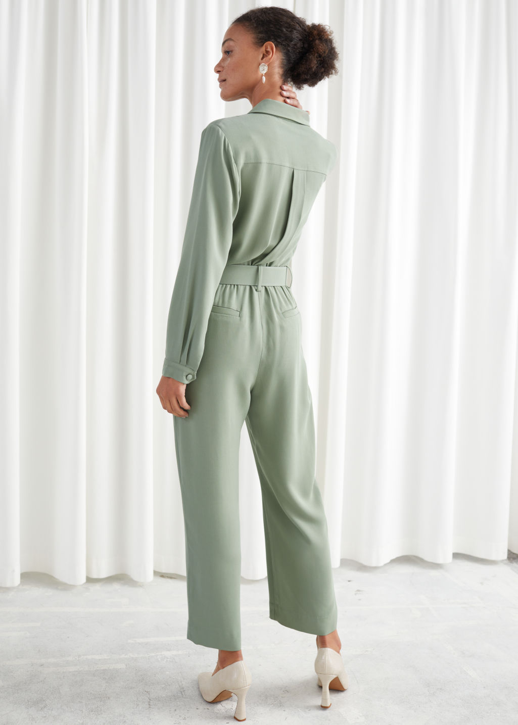 Model back image of Stories belted long sleeve jumpsuit in green