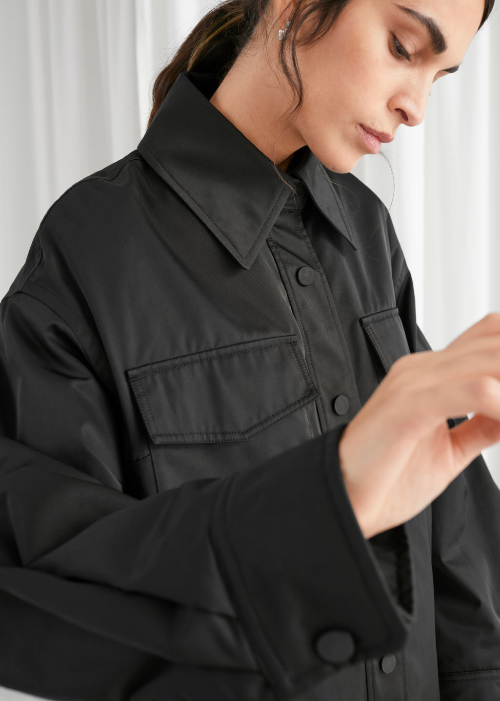 Model front image of Stories oversized padded technical jacket in black
