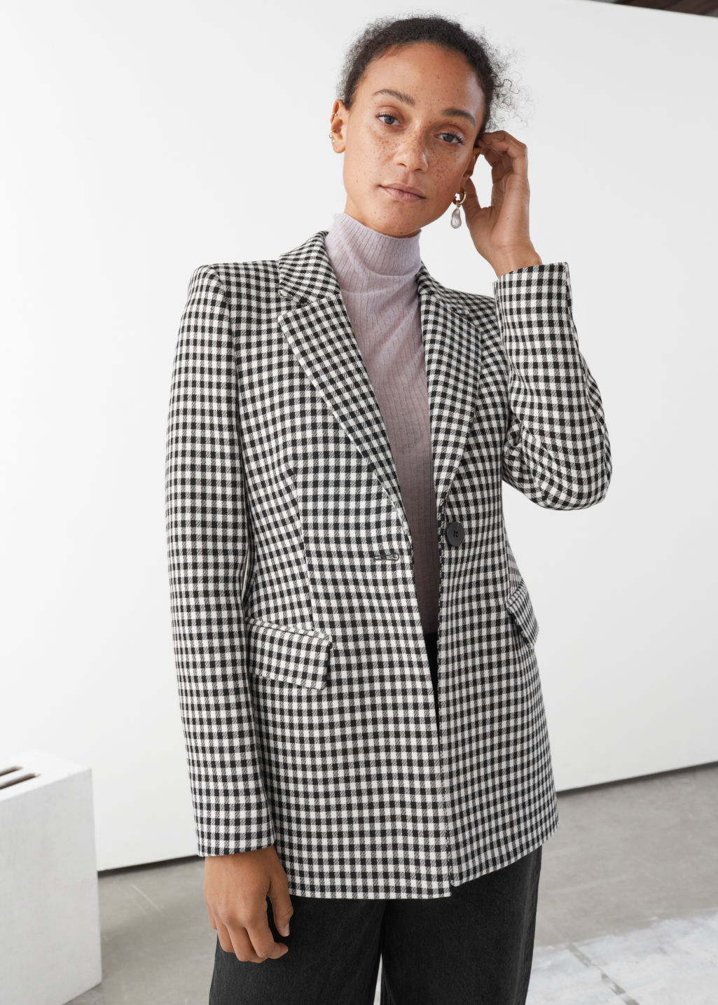 Model front image of Stories tailored gingham blazer in black