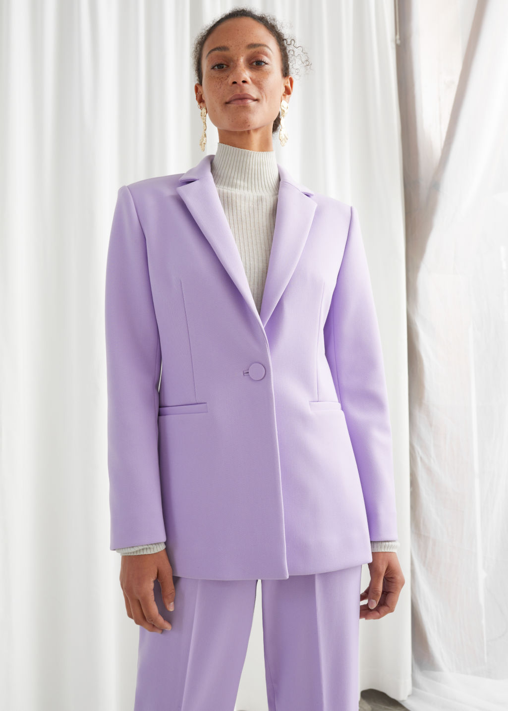 Model front image of Stories structured single button blazer in purple