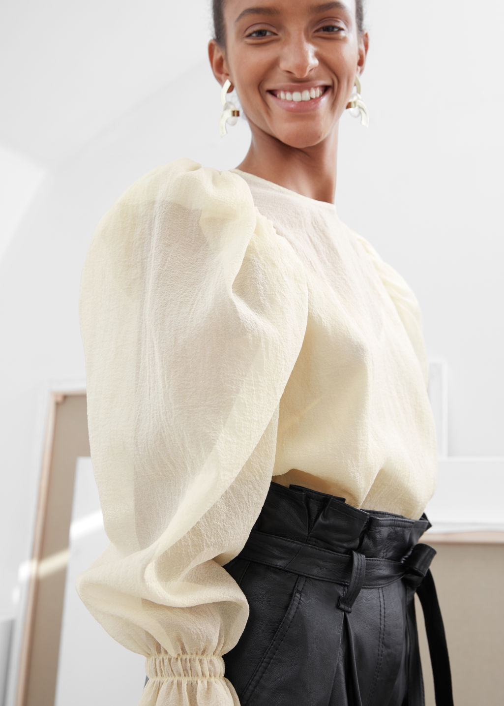 Model side image of Stories sheer puff sleeve blouse in white