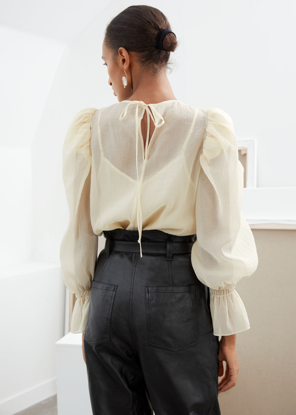 Model back image of Stories sheer puff sleeve blouse in white