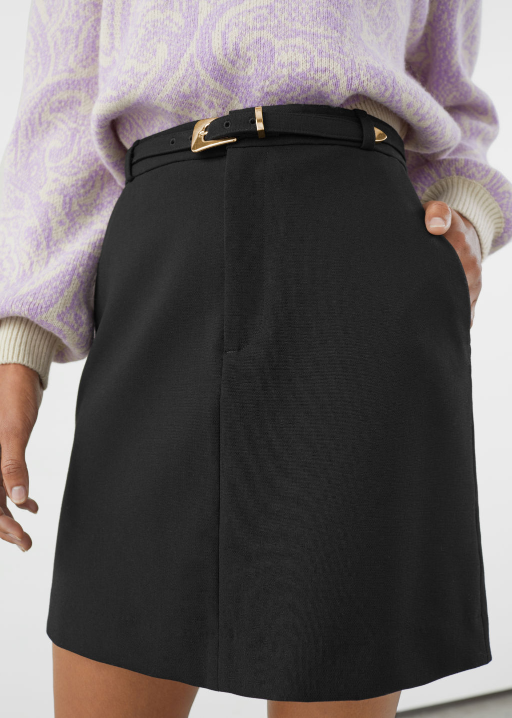 Model front image of Stories belted mini skirt in black