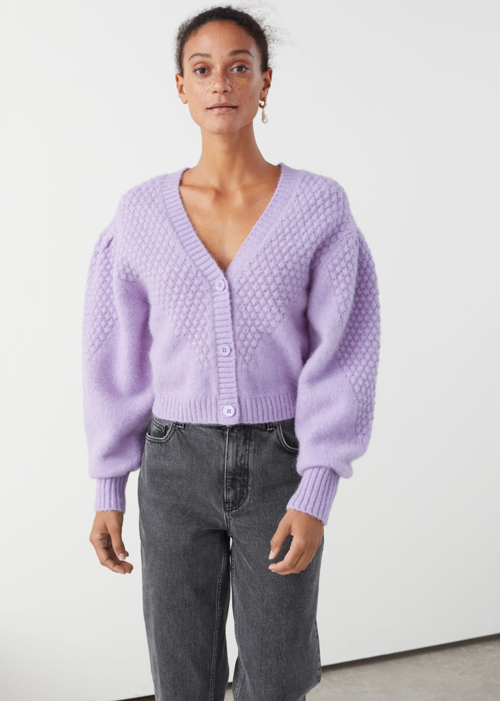 Model front image of Stories waffle knit wool blend cardigan in purple
