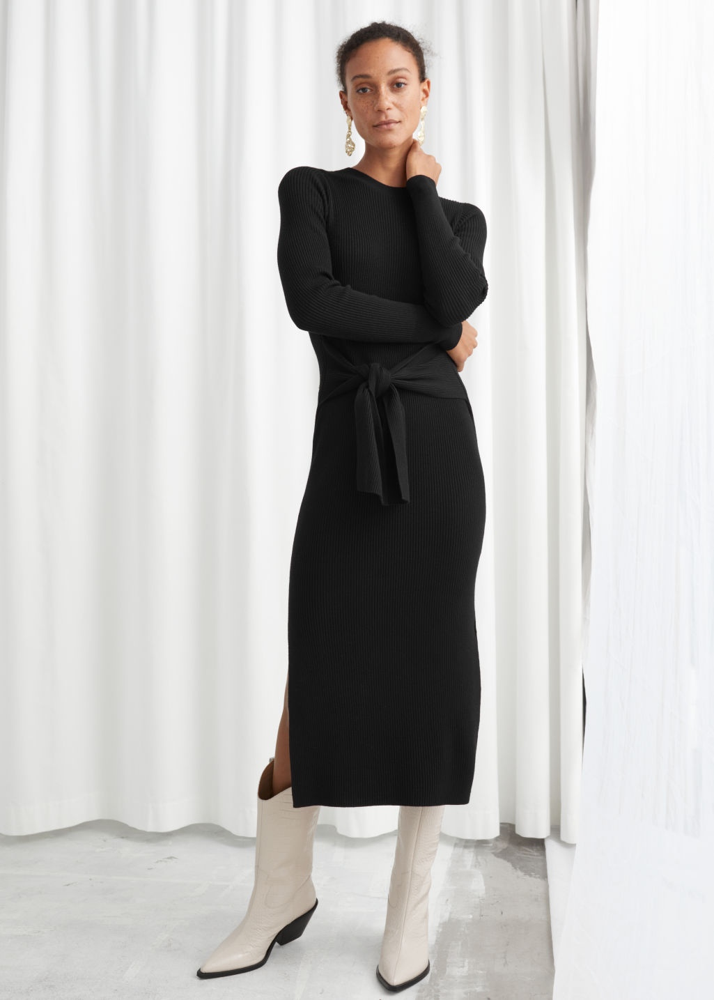 Model front image of Stories ribbed knot tie belted midi dress in black