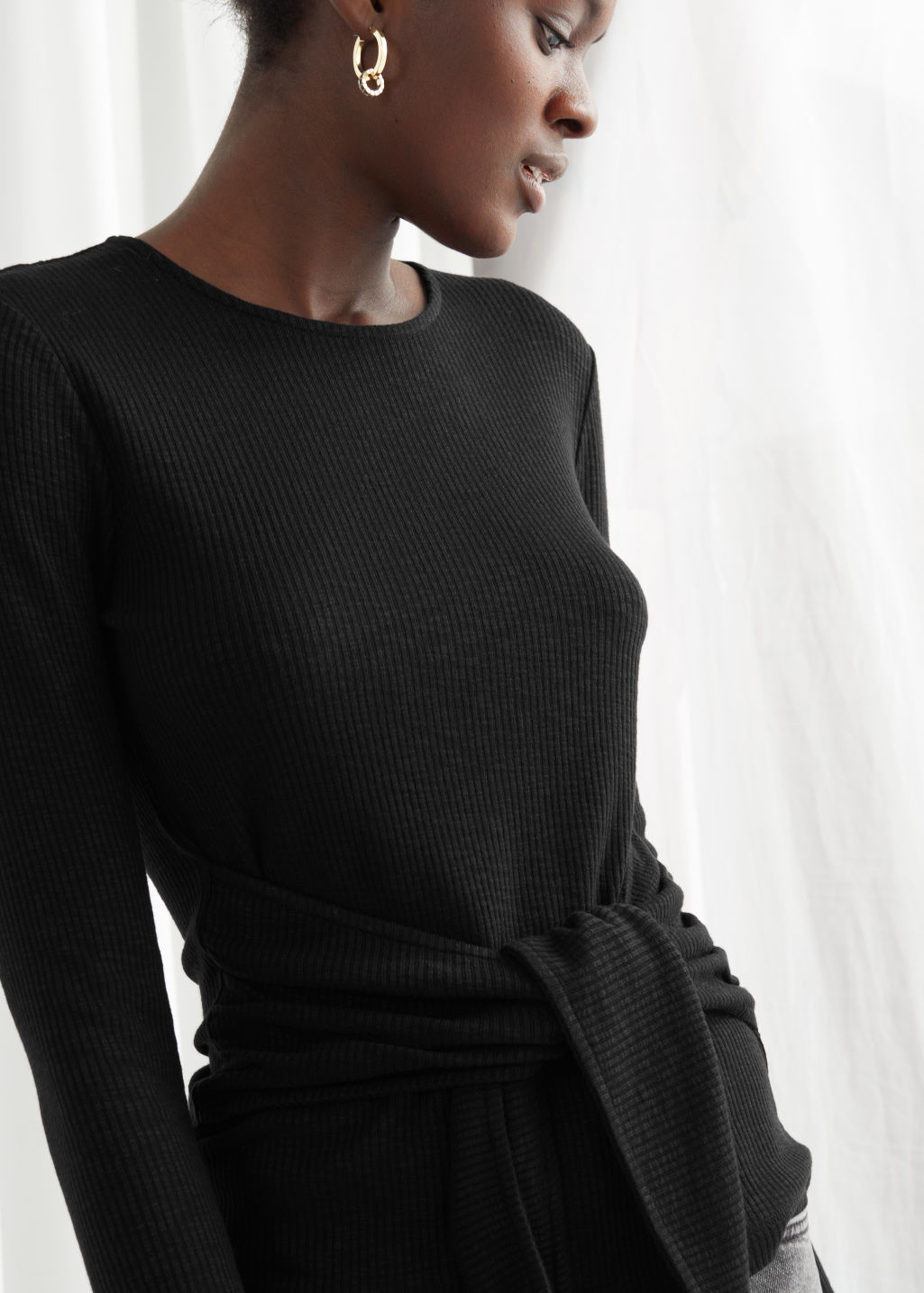 Model front image of Stories cropped tie bow top in black