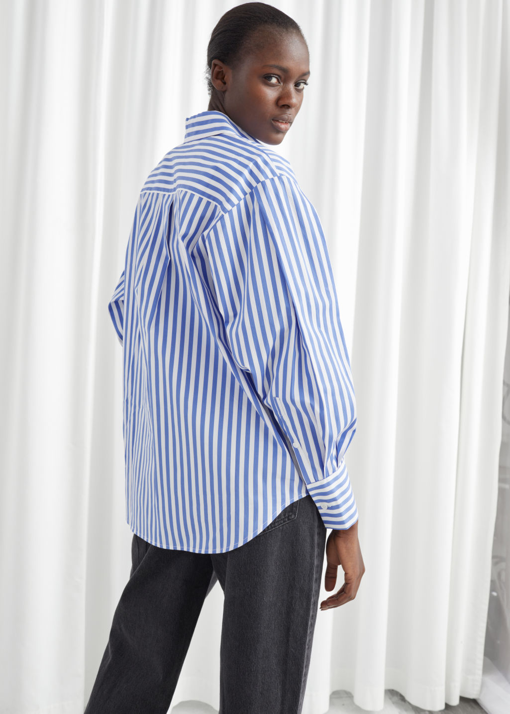 Model back image of Stories striped relaxed fit shirt in white