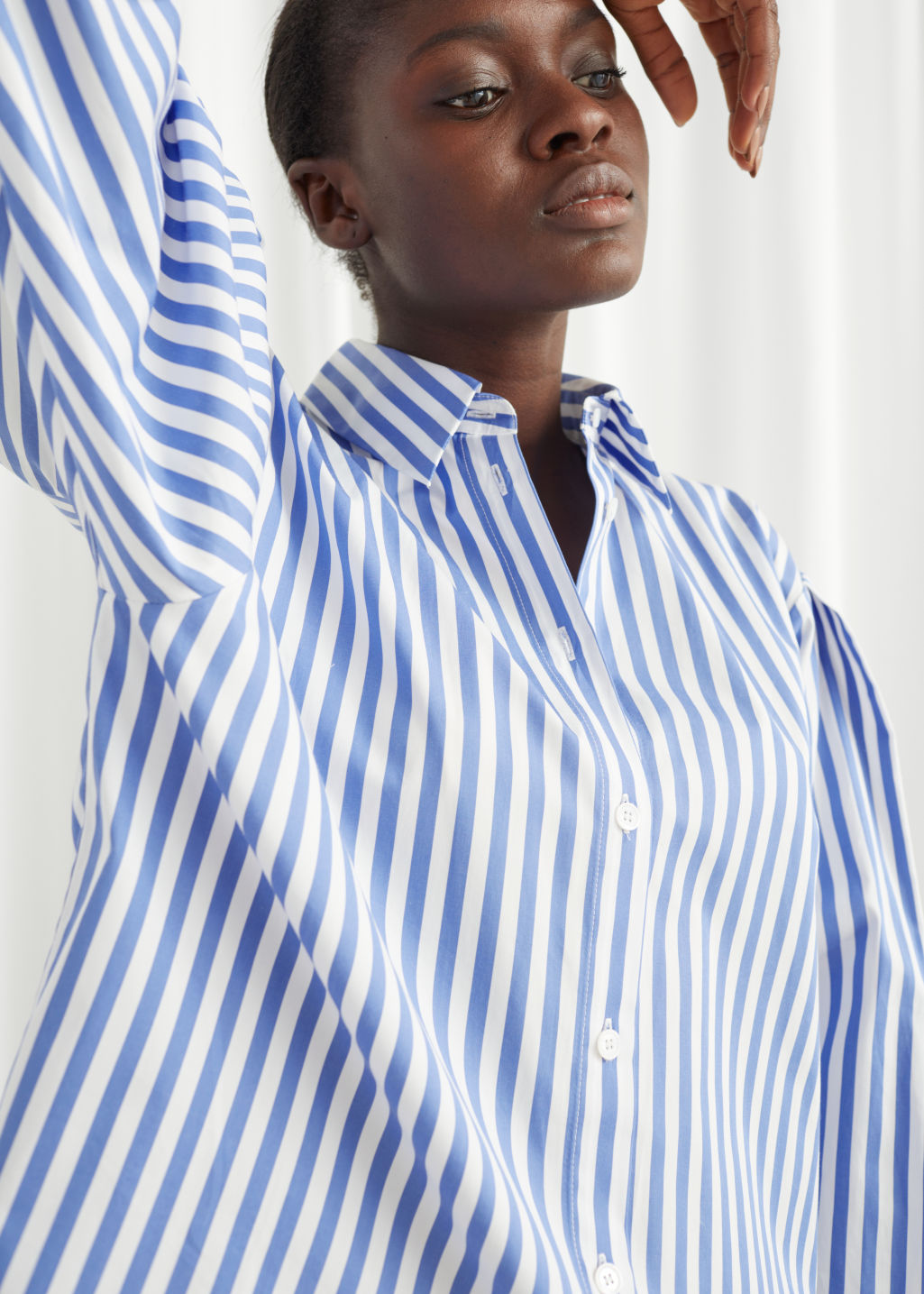 Model front image of Stories striped relaxed fit shirt in white