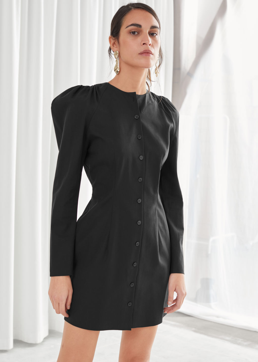 Model front image of Stories structured button up mini dress in black