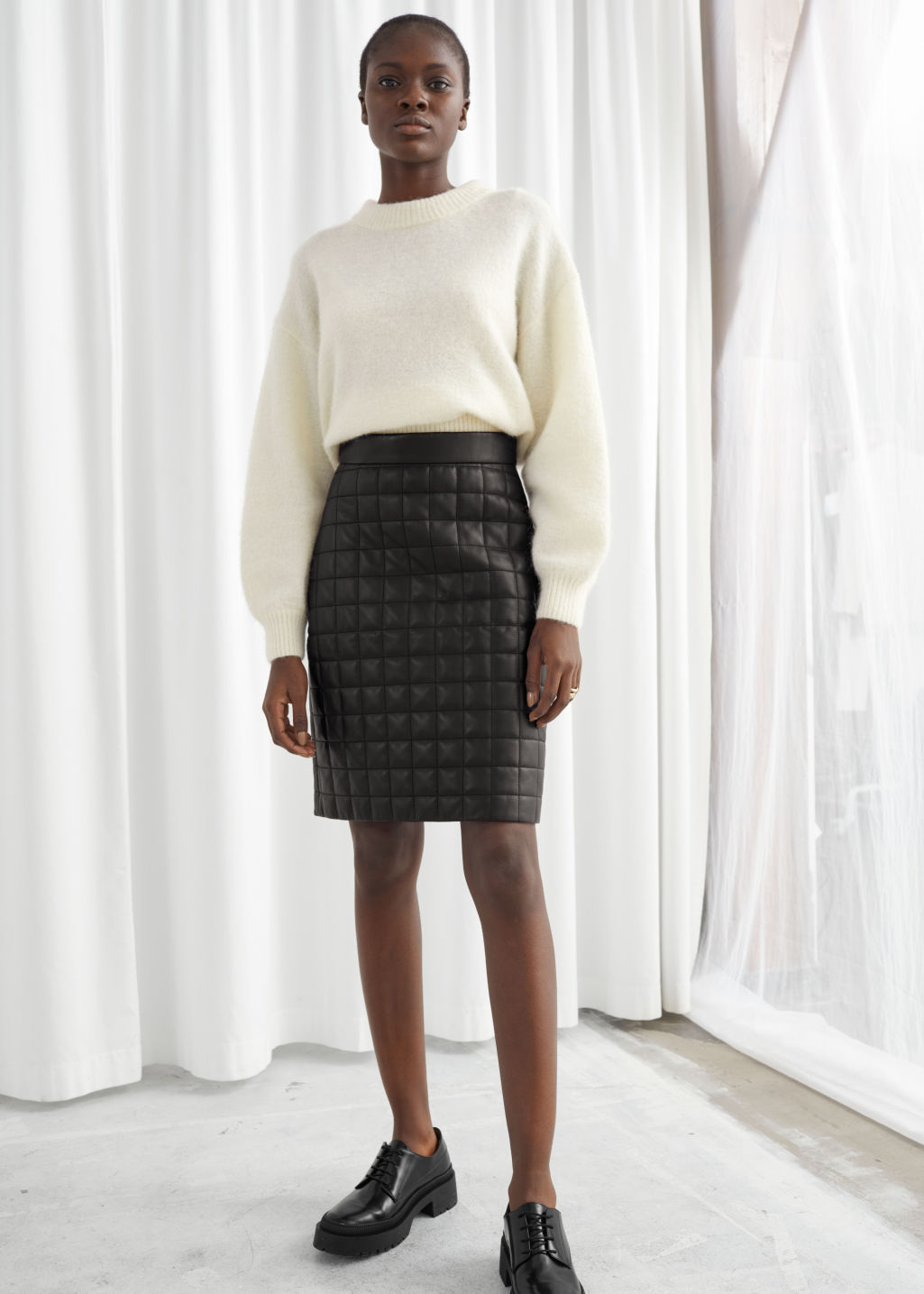 Model front image of Stories quilted leather skirt in black